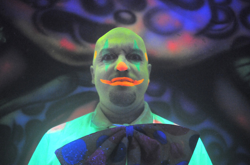 Jake a clown decorated with glow paint lit by ultraviolet light poses in the House of Darkness at the Frightmare house at 108th and Olde Wadsworth on Saturday.<br /> October 15, 2011<br /> staff photo/ David R. Jennings