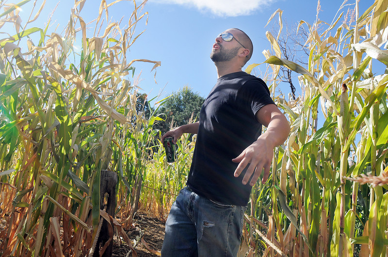 Owner Josh Holder explains the area where a scarecrow in the corn field of his Frightmare house at 108th and Olde Wadsworth on Saturday.<br /> October 15, 2011<br /> staff photo/ David R. Jennings