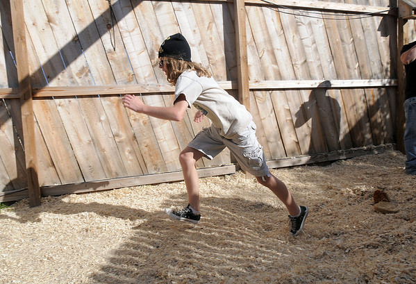 "Lou Haddad, 14, bounces across a ""quick sand"" pit during a tour of the Frightmare house at 108th and Olde Wadsworth on Saturday.<br /> October 15, 2011<br /> staff photo/ David R. Jennings"