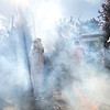 Lou Haddad, 14, walk through artificial smoke during a tour of the Frightmare house at 108th and Olde Wadsworth on Saturday.<br /> October 15, 2011<br /> staff photo/ David R. Jennings