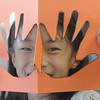 Coyote Ridge Elementay School 4th grader, Jade Martin, looks through the cut outs of her hands while making a Thanksgiving centerpiece for the residents of Highland Trail Highland Trail independent-living retirement community on Friday. <br /> November 20, 2009<br /> Staff photo/David R. Jennings