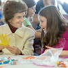 Helen Magness, left, shows Coyote Ridge Elementay School 4th grader, Abbey Nicol a cut out of her hand while they make a Thanksgiving centerpiece for the residents of  Highland Trail Highland Trail independent-living retirement community on Friday. <br /> November 20, 2009<br /> Staff photo/David R. Jennings