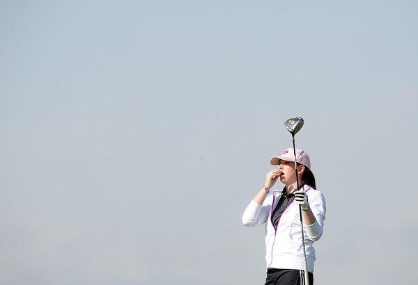 Monarch's  Ashly  Stull  watches the ball after teeinf off of the 4th hole  during the Front Range League golf tournament on Thursday at the Broadlands Golf Course.<br /> <br /> <br /> April 12, 2012 <br /> staff photo/ David R. Jennings