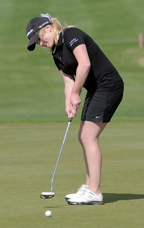 Fairview's Kelly Moran makes a putt on the 5th hole during the Front Range League golf tournament on Thursday at the Broadlands Golf Course.<br /> <br /> <br /> April 12, 2012 <br /> staff photo/ David R. Jennings