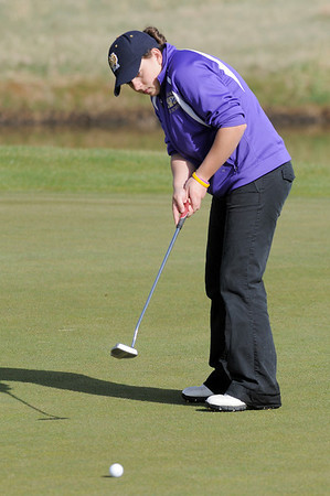 Boulder's Alex Jaros putts on the 8th green during the Front Range League golf tournament on Thursday at the Broadlands Golf Course.<br /> <br /> <br /> April 12, 2012 <br /> staff photo/ David R. Jennings