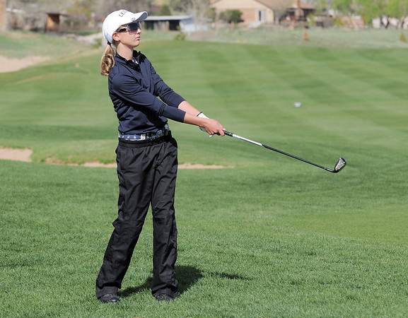 Legacy's Sarah Hankins watches the ball she chipped on the 4th hole during the Front Range League golf tournament on Thursday at the Broadlands Golf Course.<br /> <br /> <br /> April 12, 2012 <br /> staff photo/ David R. Jennings
