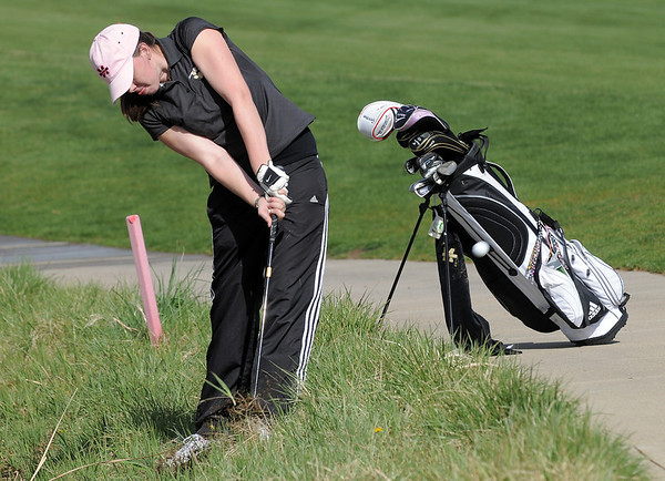 Monarch's  Ashly  Stull  chips the ball out of the rough on the 5thholeduring the Front Range League golf tournament on Thursday at the Broadlands Golf Course.<br /> <br /> <br /> April 12, 2012 <br /> staff photo/ David R. Jennings