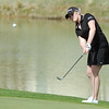 Fairview's Kelly Moran chips the ball to the 8th green during the Front Range League golf tournament on Thursday at the Broadlands Golf Course.<br /> <br /> <br /> April 12, 2012 <br /> staff photo/ David R. Jennings