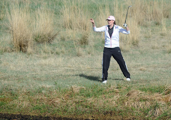 Monarch's  Ashly  Stull  reacts after hitting the ball out of the rought on the 2nd hole during the Front Range League golf tournament on Thursday at the Broadlands Golf Course.<br /> <br /> <br /> April 12, 2012 <br /> staff photo/ David R. Jennings