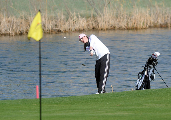 Monarch's  Ashly  Stull  chips the ball to the 3rd green during the Front Range League golf tournament on Thursday at the Broadlands Golf Course.<br /> <br /> <br /> April 12, 2012 <br /> staff photo/ David R. Jennings