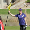 Boulder's Lucille Van Vooren holds the flag on the 2nd green during the Front Range League golf tournament on Thursday at the Broadlands Golf Course.<br /> <br /> <br /> April 12, 2012 <br /> staff photo/ David R. Jennings