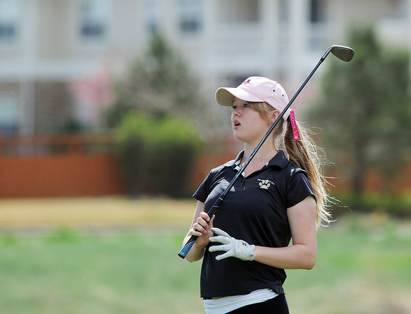 Monarch's Remy Mullen watches the ball after teeing off of the 6th hole during the Front Range League golf tournament on Thursday at the Broadlands Golf Course.<br /> <br /> <br /> April 12, 2012 <br /> staff photo/ David R. Jennings