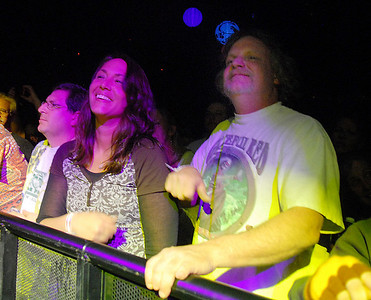 Front row fans Allison Dunn, center from Longmont, Jeremy Grossbard, left from Phoenix, AZ  and Todd Richards from Bailey listen to Furthur with Phil Lesh and Bob Weir playing at  the opening night  of the 1stBank Center on Friday.  March 5, 2010 Staff photo/David R. Jennings