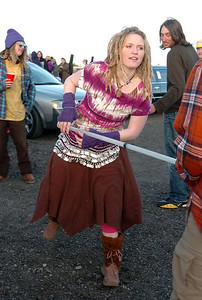 Ariel Graves, from Minnesota,  dances with a pole in a parking lot while waiting for the Furthur concert for opening night at the 1stBank Center on Friday.  March 5, 2010 Staff photo/David R. Jennings