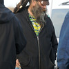 Smoke sells his wares of jewelry in a parking lot to customers waiting for the Furthur concert at the 1stBank Center on Friday.<br /> <br /> March 5, 2010<br /> Staff photo/David R. Jennings