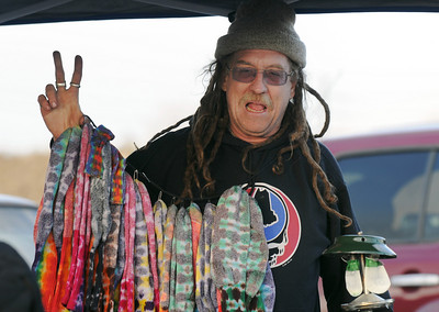 Shaggy, from California, sells his wares, tie-dyed socks, to poeple in a parking lot before the Furthur concert for opening night at the 1stBank Center on Friday.  March 5, 2010 Staff photo/David R. Jennings
