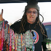Shaggy, from California, sells his wares, tie-dyed socks, to poeple in a parking lot before the Furthur concert for opening night at the 1stBank Center on Friday.<br /> <br /> March 5, 2010<br /> Staff photo/David R. Jennings