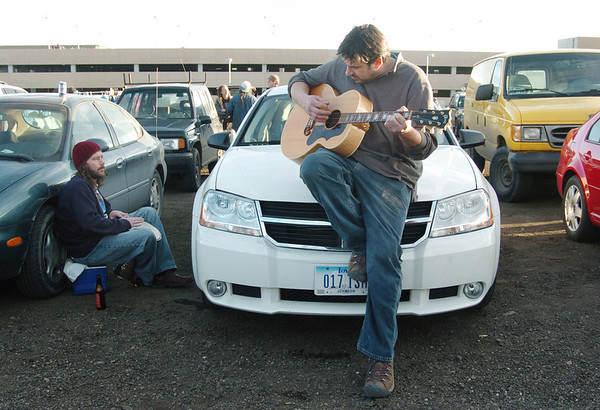 Furthur and Grateful Dead  fans  for 20 years, Derik Perez, right, and Joe Stock, both from Iowa, play music in the parking lot before the opening night  concert at the 1stBank Center on Friday.<br /> <br /> March 5, 2010<br /> Staff photo/David R. Jennings