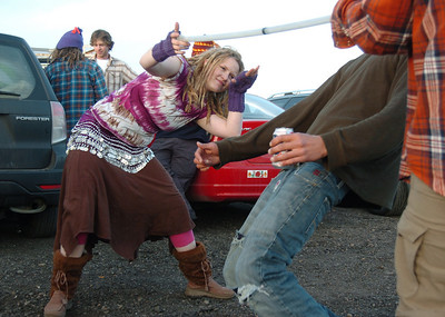 Ariel Graves, from Minnesota,  helps Gian do the limbo in a parking lot while waiting for the Furthur concert for opening night at the 1stBank Center on Friday.  March 5, 2010 Staff photo/David R. Jennings