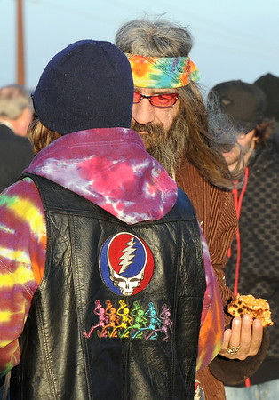Fans chat in the parking lot set aside for vendors before the Furthur concert on opening night of the 1stBank Center on Friday.<br /> <br /> March 5, 2010<br /> Staff photo/David R. Jennings