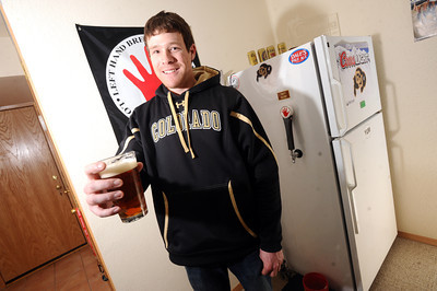Keegan Pilling with his beer tap and bar in his Gold Run apartment in Boulder. For a video of Pilling showing off his nice living quarters go to www.coloradodaily.com Photo by Paul Aiken
