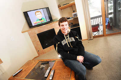 Keegan Pilling with a flat screen TV, gas fireplace and deck in his Gold Run apartment in Boulder. For a video of Pilling showing off his nice living quarters go to www.coloradodaily.com Photo by Paul Aiken