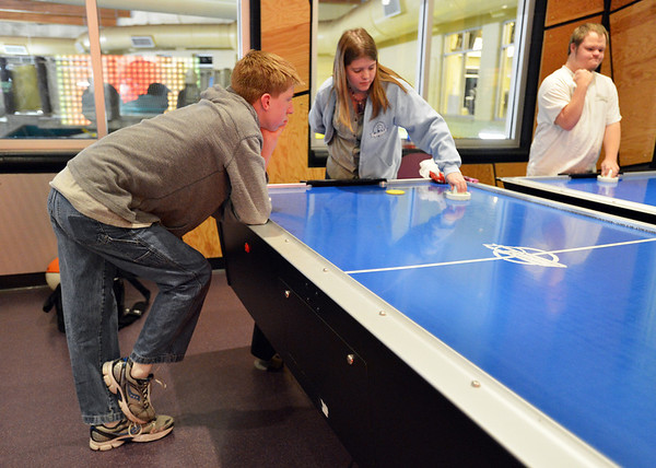 Shawn Clark, left, watches Jennifer Eck play an air hockey game during Game Night at the Derda Recreation Center on Saturday.<br /> January 19, 2013<br /> staff photo/ David R. Jennings