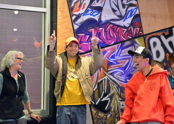 Luke Langston, center, signals the score of an air hockey game as volunteer Lynn Weis, left, and Cole Campbell laugh during Game Night at the Derda Recreation Center on Saturday.<br /> January 19, 2013<br /> staff photo/ David R. Jennings
