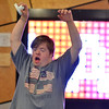 Kyle Cecil cheers after scoring a point in an air hockey game during Game Night at the Derda Recreation Center on Saturday.<br /> January 19, 2013<br /> staff photo/ David R. Jennings