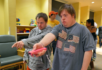 Troy Fielder, left, helps Kyle Cecil with using a Wii to select a song to dance to during Game Night at the Derda Recreation Center on Saturday. January 19, 2013 staff photo/ David R. Jennings