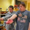 Troy Fielder, left, helps Kyle Cecil with using a Wii to select a song to dance to during Game Night at the Derda Recreation Center on Saturday.<br /> January 19, 2013<br /> staff photo/ David R. Jennings