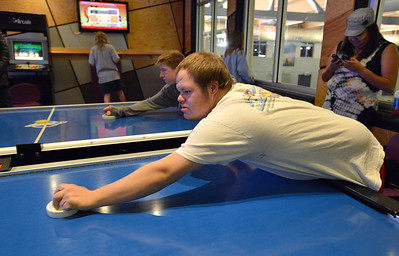 Troy Fielder, front, and Shawn Clark play air hockey games during Game Night at the Derda Recreation Center on Saturday. January 19, 2013 staff photo/ David R. Jennings