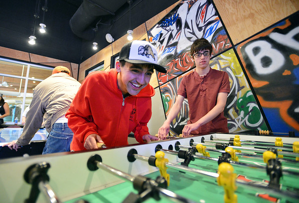 Cole Campbell, left, and Anthony Traver team up to play Foosball game during Game Night at the Derda Recreation Center on Saturday.<br /> January 19, 2013<br /> staff photo/ David R. Jennings