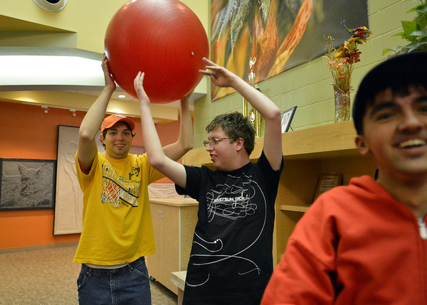 Mason Butts, right, passes a ball to Luke Campbell during Game Night at the Derda Recreation Center on Saturday.<br /> January 19, 2013<br /> staff photo/ David R. Jennings