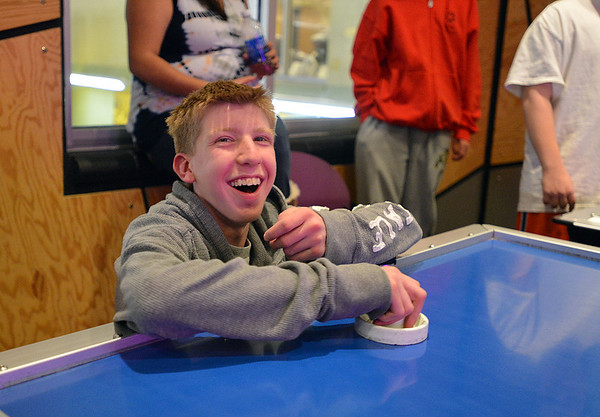 Shawn Clark, 15, laughs while playing an air hockey game during Game Night at the Derda Recreation Center on Saturday.<br /> January 19, 2013<br /> staff photo/ David R. Jennings