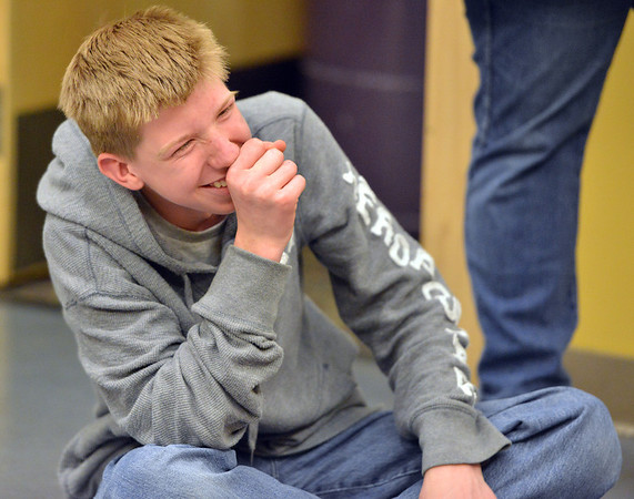 Shawn Clark, 15, laughs while trying to answer a question during Game Night at the Derda Recreation Center on Saturday.<br /> January 19, 2013<br /> staff photo/ David R. Jennings