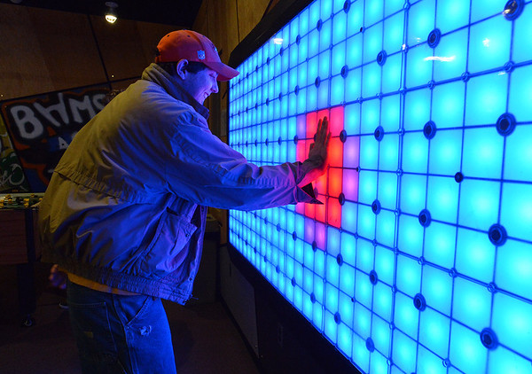 Luke Langston pushes light squares while playing a lights game during Game Night at the Derda Recreation Center on Saturday.<br /> January 19, 2013<br /> staff photo/ David R. Jennings