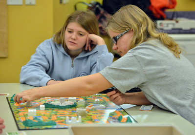Jennifer Eck and Claire Duclos play The Game of LIFE during Game Night at the Derda Recreation Center on Saturday. January 19, 2013 staff photo/ David R. Jennings