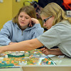 Jennifer Eck and Claire Duclos play The Game of LIFE during Game Night at the Derda Recreation Center on Saturday.<br /> January 19, 2013<br /> staff photo/ David R. Jennings