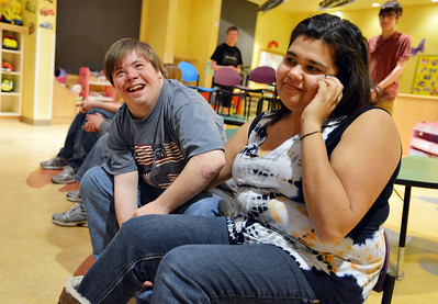 Kyle Cecil, left, jokes with Ashleigh Wagner during Game Night at the Derda Recreation Center on Saturday. January 19, 2013 staff photo/ David R. Jennings