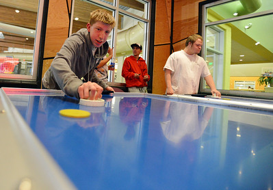 Shawn Clark plays an air hockey game during Game Night at the Derda Recreation Center on Saturday. January 19, 2013 staff photo/ David R. Jennings
