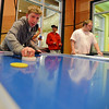 Shawn Clark plays an air hockey game during Game Night at the Derda Recreation Center on Saturday.<br /> January 19, 2013<br /> staff photo/ David R. Jennings