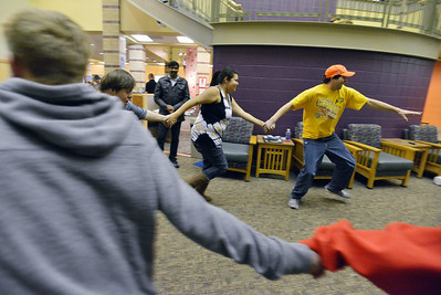 Luke Langston, right, leads Ashleigh Wagner, Kyle Cecil and others in a game during Game Night at the Derda Recreation Center on Saturday. January 19, 2013 staff photo/ David R. Jennings
