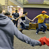 Luke Langston, right, leads Ashleigh Wagner, Kyle Cecil and others in a game during Game Night at the Derda Recreation Center on Saturday.<br /> January 19, 2013<br /> staff photo/ David R. Jennings