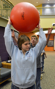 Jennifer Eck, front, passes a ball back to Shawn Clark, 15, during Game Night at the Derda Recreation Center on Saturday. January 19, 2013 staff photo/ David R. Jennings