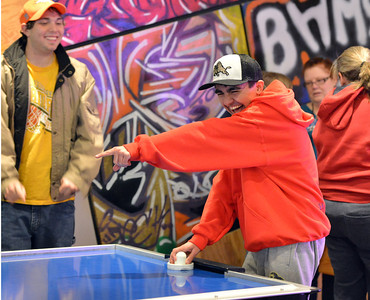 Cole Campbell laughs at where his air hockey puck lands during Game Night at the Derda Recreation Center on Saturday. January 19, 2013 staff photo/ David R. Jennings