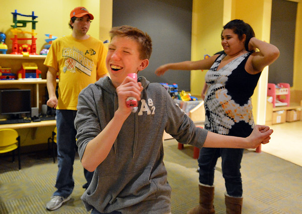 Shawn Clark, 15, dances to a song with a Wii game during Game Night at the Derda Recreation Center on Saturday.<br /> January 19, 2013<br /> staff photo/ David R. Jennings