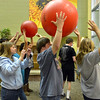 Jennifer Eck, left, Kyle Cecil and Claire Duclos participate in a passing the ball game during Game Night at the Derda Recreation Center on Saturday.<br /> January 19, 2013<br /> staff photo/ David R. Jennings