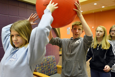 Jennifer Eck, let,t passes a ball to Shawn Clark, 15, and his sister Michelle Clark, 13,  during Game Night at the Derda Recreation Center on Saturday. January 19, 2013 staff photo/ David R. Jennings