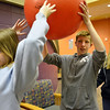 Jennifer Eck, let,t passes a ball to Shawn Clark, 15, and his sister Michelle Clark, 13,  during Game Night at the Derda Recreation Center on Saturday.<br /> January 19, 2013<br /> staff photo/ David R. Jennings
